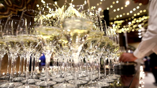 waiter in uniform serving champagne - stereotypically upper class stock videos & royalty-free footage