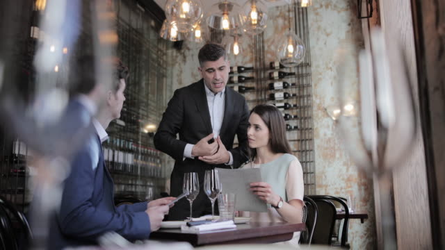 waiter making recommendation in a restaurant - luxury stock videos & royalty-free footage