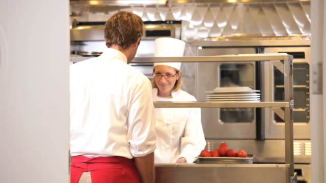 ms r/f waiter picking up food from restaurant kitchen / richmond, virginia, usa - richmond virginia stock videos & royalty-free footage