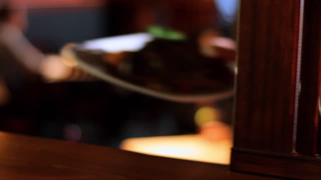 a waiter picks up plates of food in a restaurant. - steak stock videos & royalty-free footage