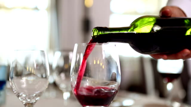 waiter pouring a bottle of red wine - serving food and drinks stock videos & royalty-free footage