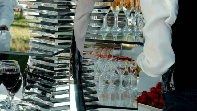 waiter pouring alcohol in glasses for reception - formal reception stock videos and b-roll footage
