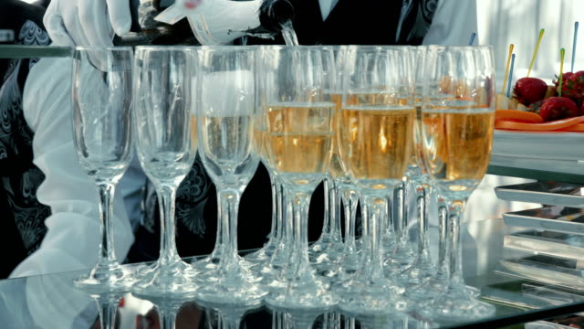 waiter pouring champagne for reception - formal reception stock videos and b-roll footage