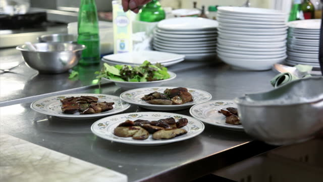 waiter puts parsley onto porcini mushrooms - ready to eat stock videos & royalty-free footage