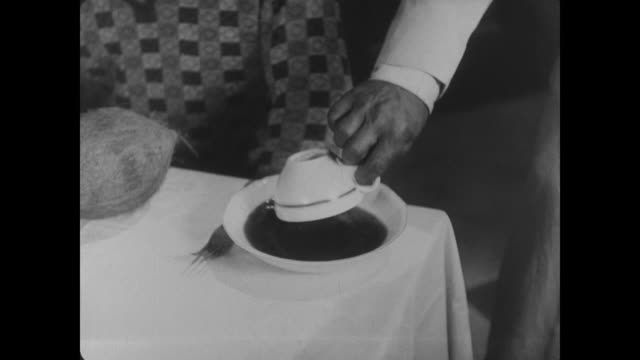 1927 Waiter (Buster Keaton) serves coffee in an unorthodox manner
