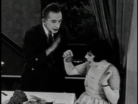 1920 MONTAGE Waiter serves food to woman in balcony then accidentally drops tray on patrons below