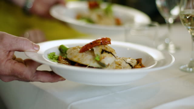 waiter serves two means - fish and vegetables - seafood stock videos & royalty-free footage