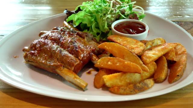 waiter serving bbq pork rib - rib food stock videos and b-roll footage