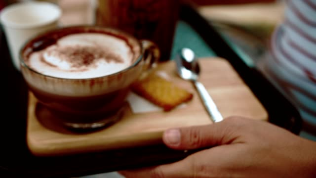cu : waiter serving coffee - hot chocolate stock videos and b-roll footage