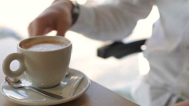 waiter serving cup of fresh coffee for young man - cafeteria worker stock videos and b-roll footage