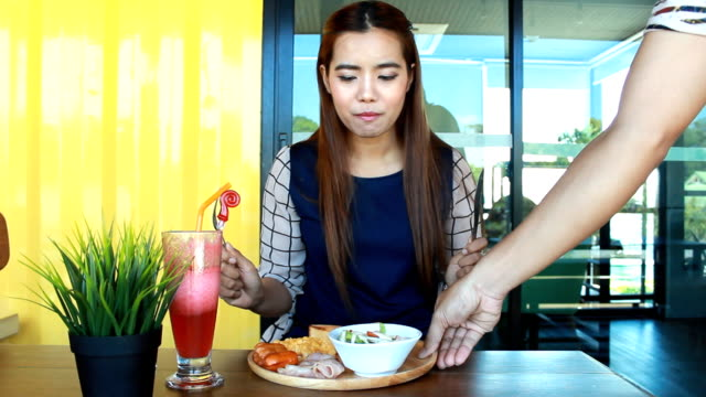 Waiter Serving Lunch in Restaurant