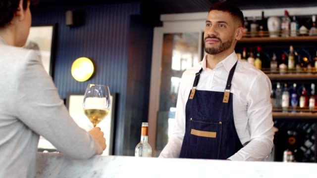 waiter serving white wine - bar drink establishment stock videos & royalty-free footage