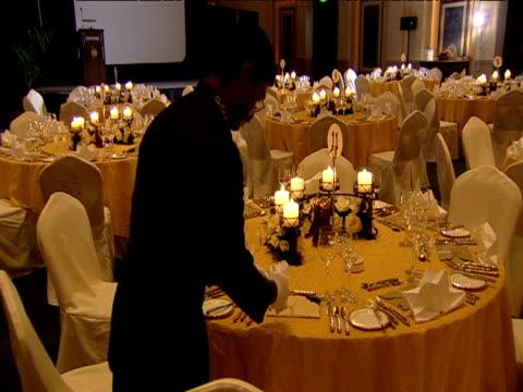 vidéos et rushes de waiter sets table in luxurious hotel restaurant dubai - palace