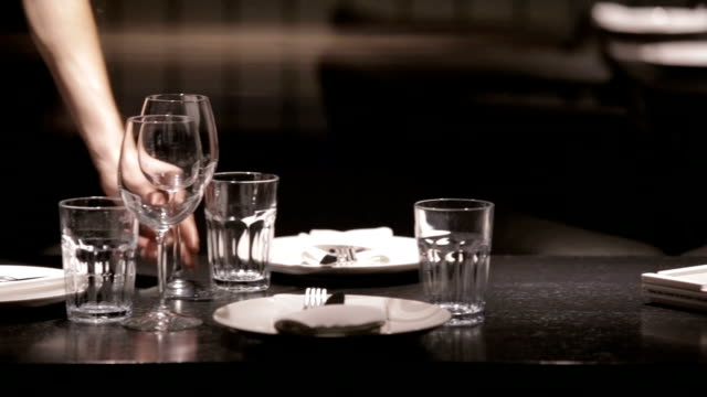 waiter setting the table in restaurant - silver service stock videos & royalty-free footage