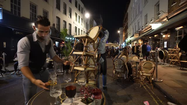 waiter stacks chairs outside a restaurant in soho on november 4, 2020 in london, england. non-essential businesses, including pubs and restaurants,... - stack stock videos & royalty-free footage