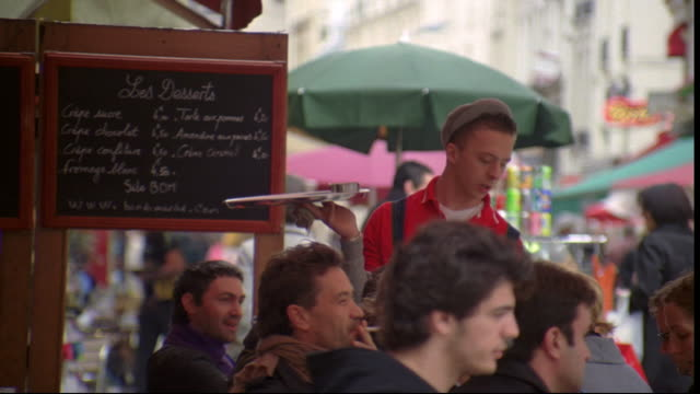 a waiter talks to customers at an outdoor cafe in paris, france. - ile de france stock videos and b-roll footage