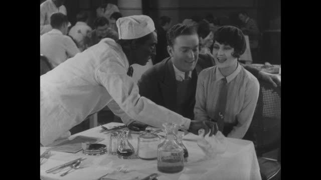 1927 Waiter (Buster Keaton) waits on familiar faces