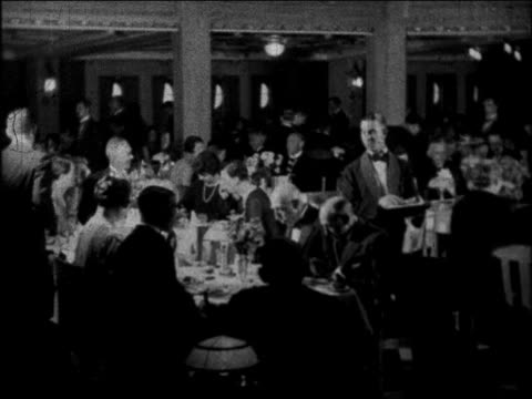 b/w 1930 waiters serving passengers in dining room on ocean liner / educational - anno 1930 video stock e b–roll