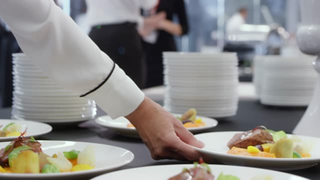 waiters taking plates with the main course off the table - stack of plates stock videos & royalty-free footage
