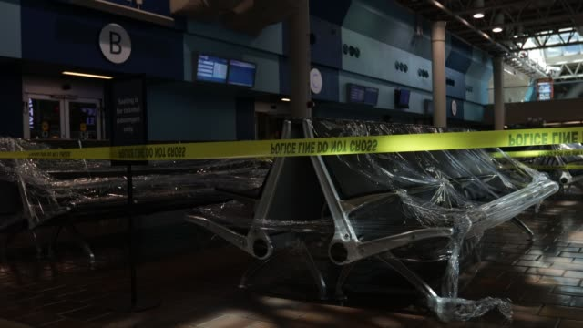waiting area chairs are covered in plastic wrap at the concourse of union station during the coronavirus pandemic on april 3, 2020 in washington, dc.... - maryland stato video stock e b–roll
