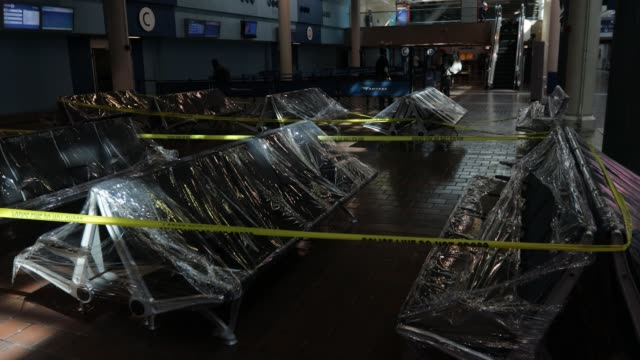waiting area chairs are covered in plastic wrap at the concourse of union station during the coronavirus pandemic on april 3, 2020 in washington, dc.... - maryland us state stock videos & royalty-free footage