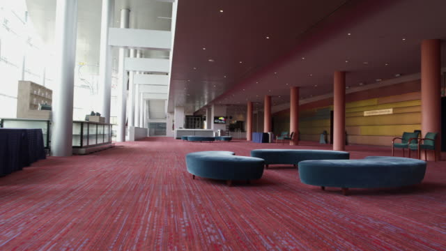 waiting area in foyer by hall of theatre. - カーペット点の映像素材/bロール