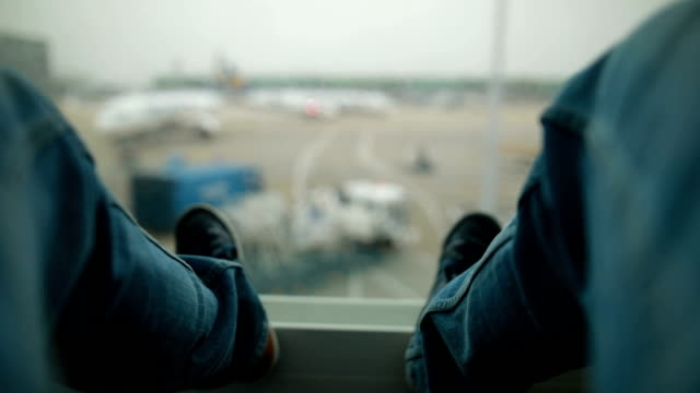 waiting at the airport - footwear stock videos and b-roll footage