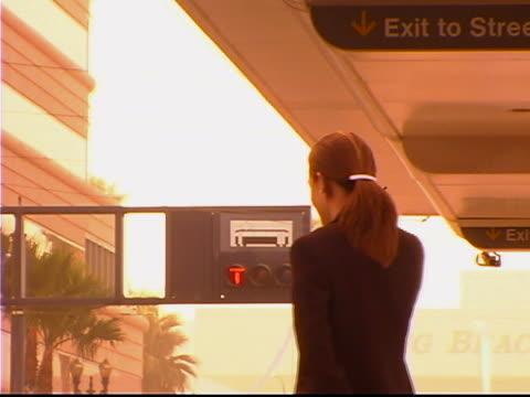 waiting at train station - dreiviertelansicht stock-videos und b-roll-filmmaterial