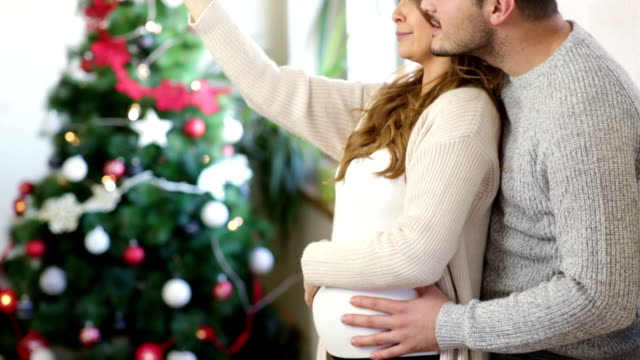 waiting for christmas and baby - hugging tree stock videos & royalty-free footage