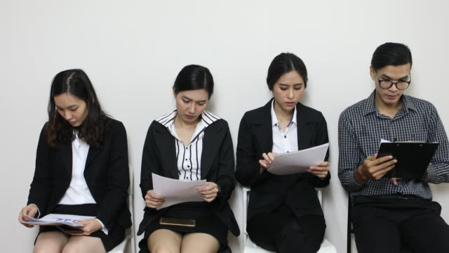 waiting for job interview - people in a row stock videos and b-roll footage