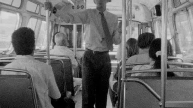 Waiting for Los Angeles Metro bus / Various angles of riding on bus / exiting bus / Riding Metro Bus on November 01 1989 in Los Angeles California