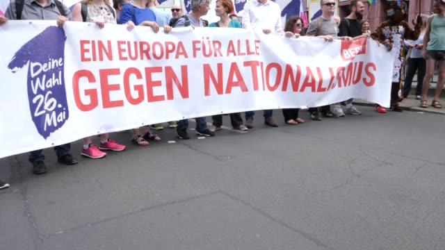 """waiting for the beginning of the demonstration at alexanderplatz, protesters with a banner reading: """"against nationalism: a europe for all."""" .... - populism stock videos & royalty-free footage"""