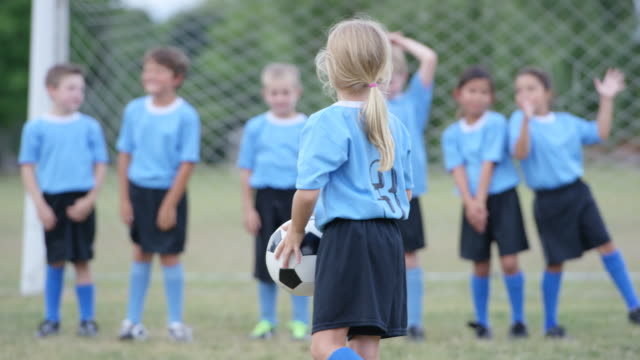 waiting for the soccer game to start - girls stock videos & royalty-free footage