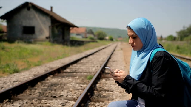 waiting for train - modest clothing stock videos & royalty-free footage