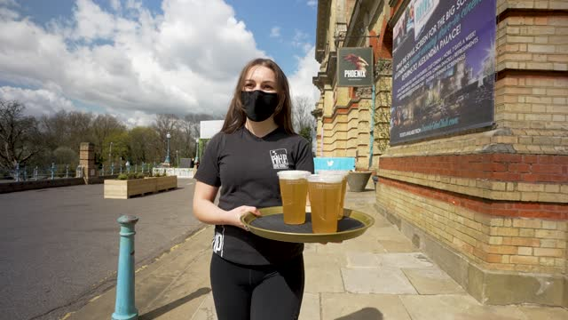 waiting staff bring out alcoholic drinks on trays at alexandra palace the terrace bar on april 12, 2021 in london, united kingdom. england has taken... - concepts & topics stock videos & royalty-free footage