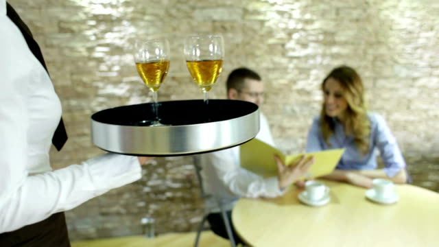 hd: waitress carry wine for guests. - servitris bildbanksvideor och videomaterial från bakom kulisserna