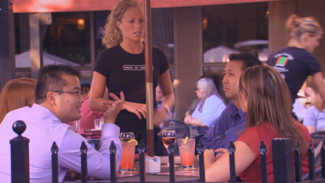 Waitress Checking on Table