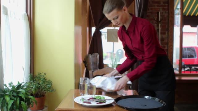 waitress clearing table in restaurant - servitris bildbanksvideor och videomaterial från bakom kulisserna