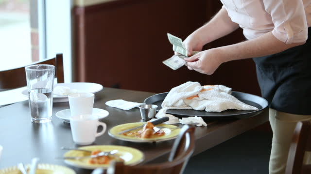 waitress picking up her tip, clearing table - gratuity stock videos & royalty-free footage