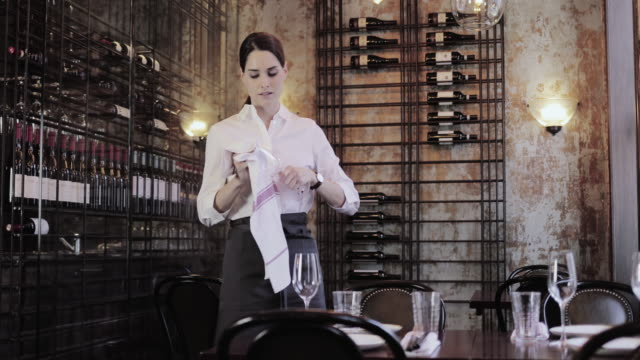 vídeos y material grabado en eventos de stock de waitress polishing a wine glass - camarero