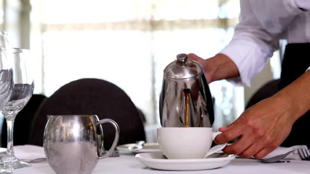 Waitress pouring tea