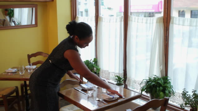waitress setting up restaurant table - waitress stock videos & royalty-free footage