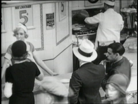 waitress talks to customers at a soda fountain. - 1930 stock videos & royalty-free footage