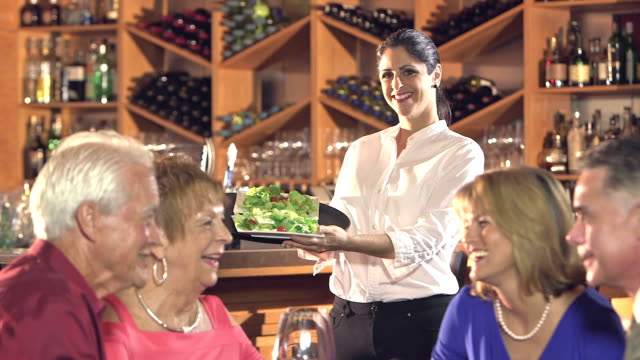 waitress with serving tray of salads, customers talking - serving tray stock videos and b-roll footage