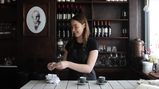 waitress working in cool cafe serving coffee - part time worker stock videos & royalty-free footage