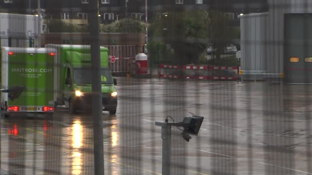 waitrose distribution centre general views; england: london: enfield: ext / raining gvs waitrose distribution centre with lorries/vans parked outside... - mode of transport stock videos & royalty-free footage
