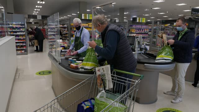 waitrose interior gvs; england: surrey: horley: int gvs customers and produce in fresh section / gvs staff putting vegetables out on display /... - vegetable stock videos & royalty-free footage