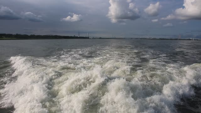 wake behind luxury yacht sailing in tokyo bay - wake water stock videos and b-roll footage