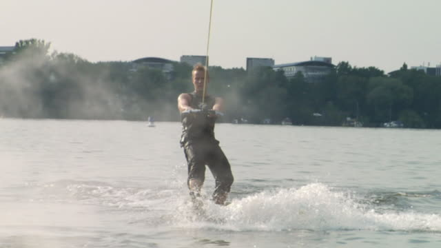 slo mo ws wake boarder riding wave on water / potsdam, germany - one mid adult man only stock videos & royalty-free footage