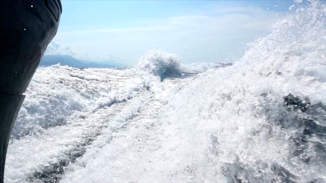 slo mo wake of a motorboat in the sea - boat point of view stock videos and b-roll footage